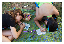 "Two young girls participating in a Witness Tree postcard-writing event (left) and examples of a ""Witness Tree"" image and a handmade postcard, New York, New York, USA, 2014"